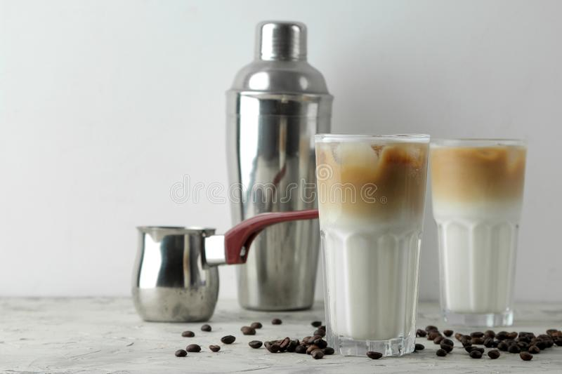 Ice latte or Iced coffee with milk and ice cubes in a glass beaker on a light background. refreshing drink. summer drink. Ice latte or Iced coffee with milk and stock image