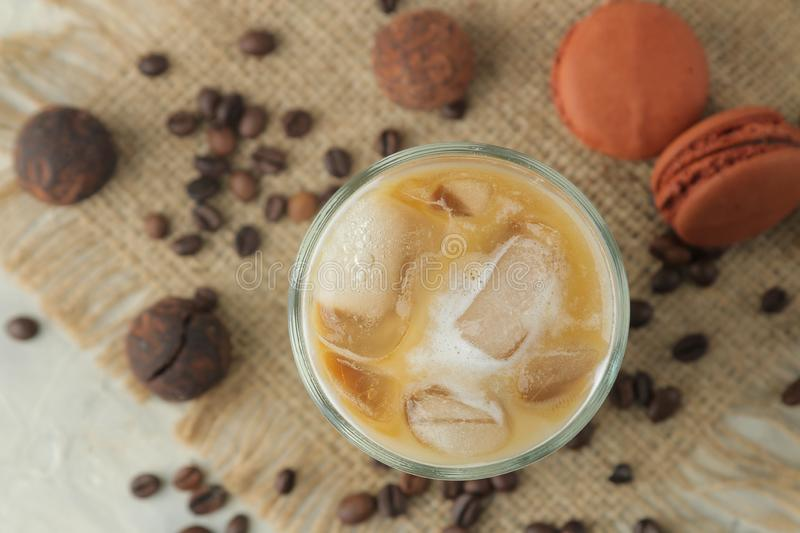Ice latte or Iced coffee with milk and ice cubes in a glass beaker on a light background. refreshing drink. summer drink. top view. Ice latte or Iced coffee with royalty free stock photos