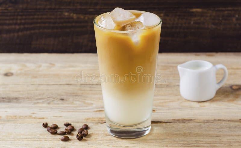 Ice latte on wood background 2. Ice latte on wood background ice latte on wood background royalty free stock images