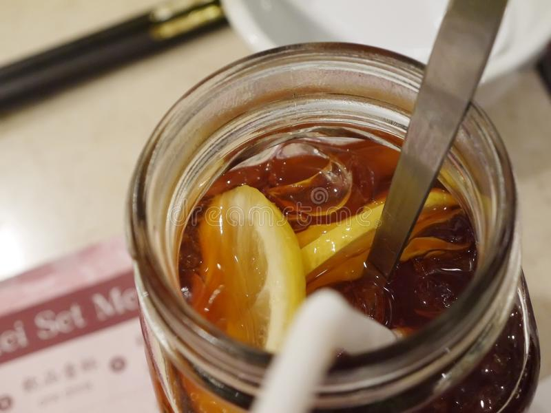 Ice lemon tea in glass button at Chinese restaurant. S stock photography