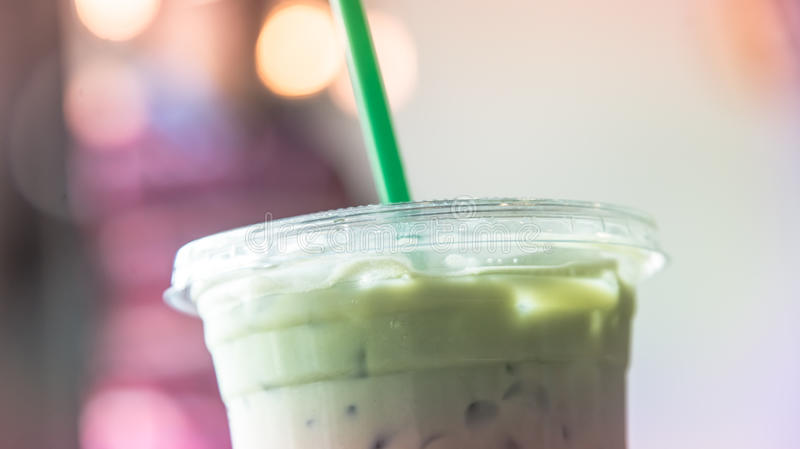 Ice matcha latte cup in cafe pastel tone. Ice matcha latte cup in cafe rainbow pastel like instagram filter stock photos