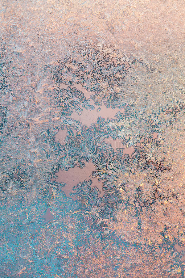 Ice patterns on winter glass. Frost Background royalty free stock image