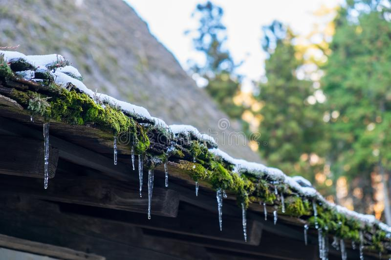 Ice perched on the roof after the snow begins to melt. The ice perched on the roof after the snow begins to melt stock images