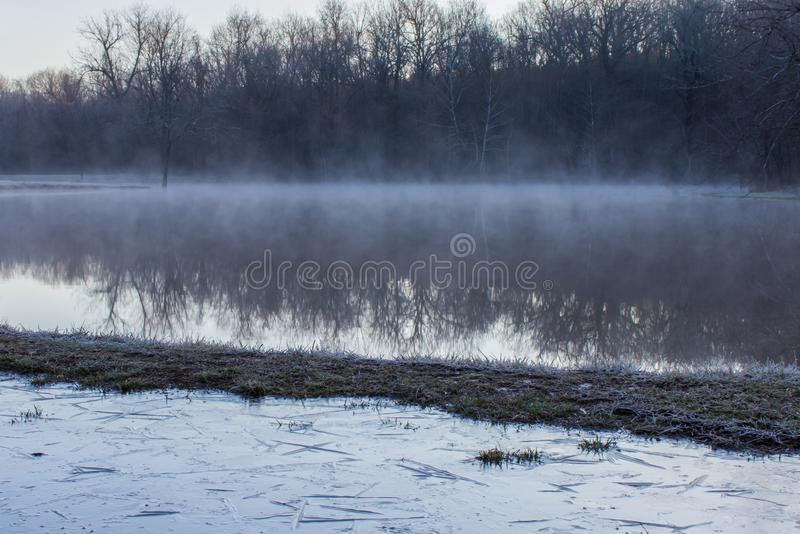 Ice puddle and pond stock images