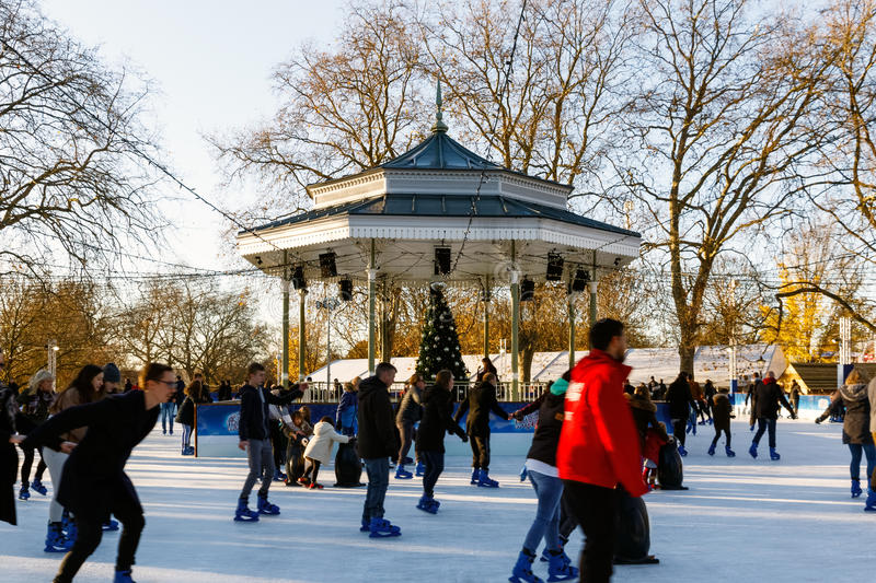 Ice Rink at Winter Wonderland, London. London, UK - November 25, 2016 - People ice skating at Winter Wonderland, a Christmas fair in Hyde Park stock photography