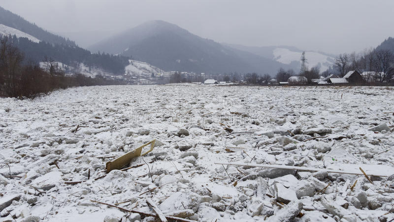 Ice on river Bistrita in Romania. Dangerous view of ice on Bistrita river, Romania in winter scene royalty free stock photography