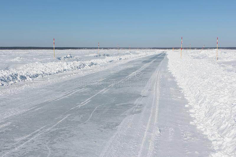 Ice road in snow on the frozen water reservoir in the winter royalty free stock photo