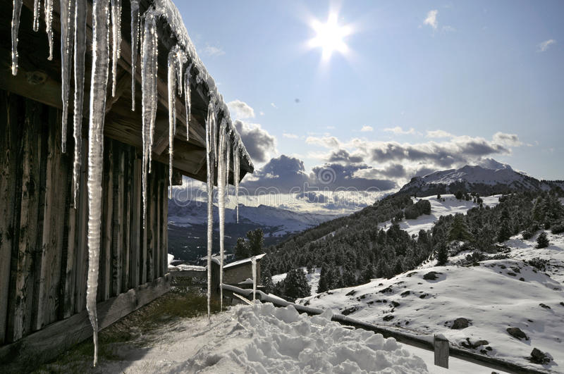 Ice from the roof of a hut in Val Gardena royalty free stock image