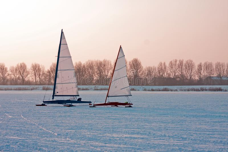 Ice sailing on a cold winter day on the Gouwzee in the Netherlands at sunset royalty free stock photo