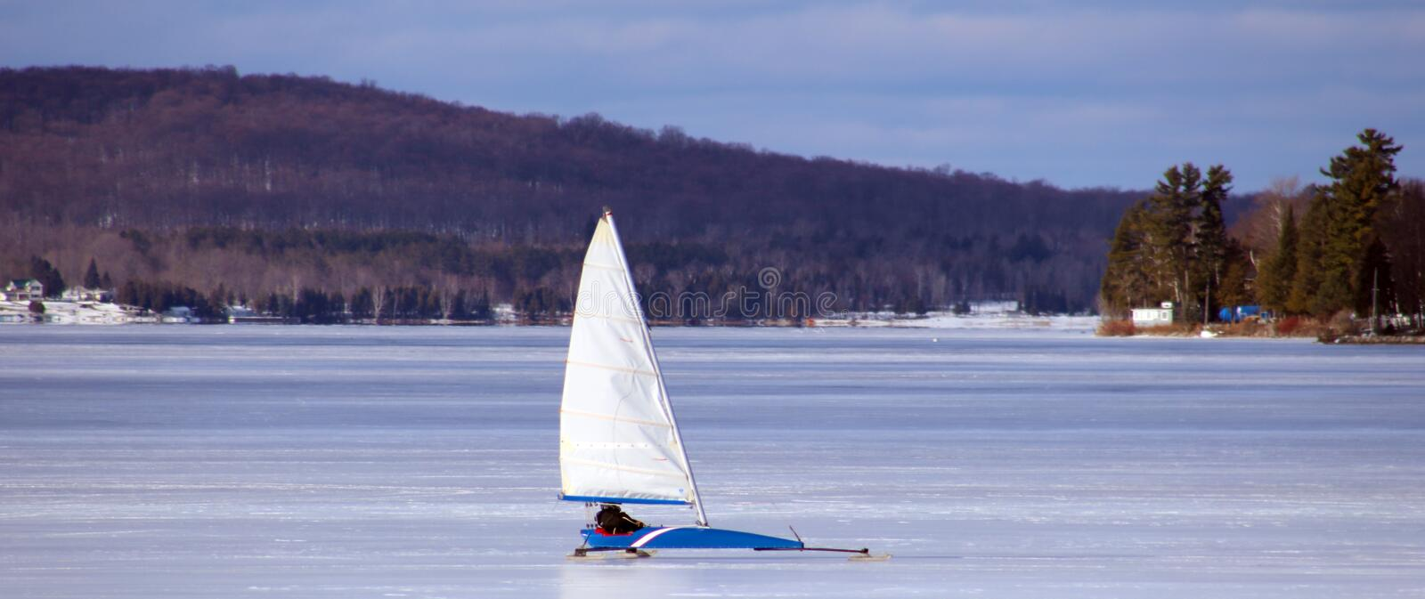 Ice sailing in froze lake in north Michigan during winter stock photo