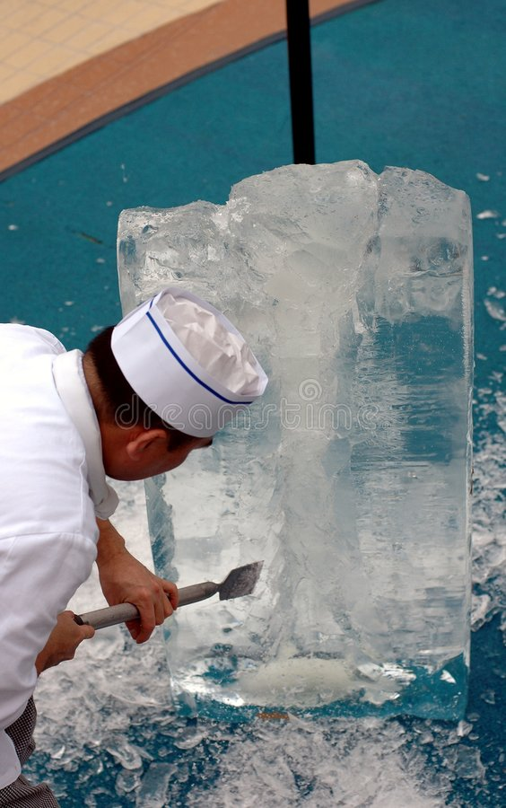 Ice Sculpting. Man sculpting ice on cruise ship.Demostration royalty free stock image
