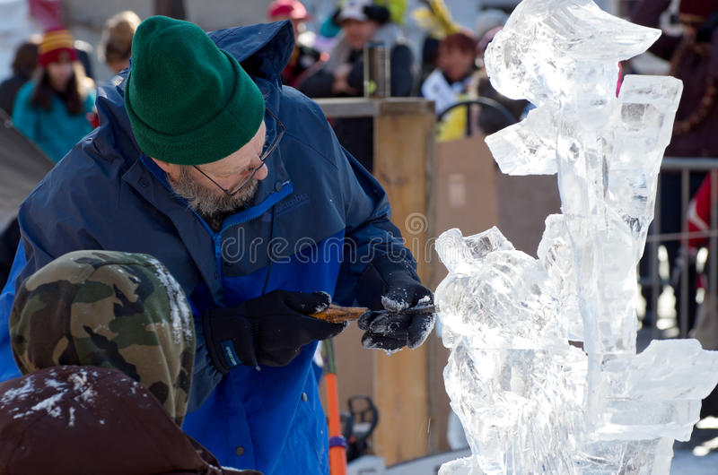 Ice Sculptor and Assistant at Winter Carnival stock photos