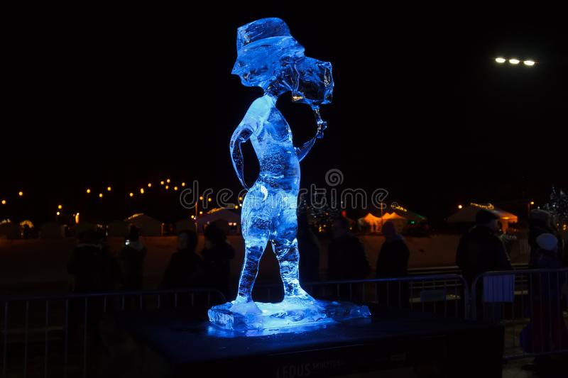 Ice Sculpture Boy with icecream in Jelgava, Latvia in February 9, 2019. Ice Sculpture And Light Festival in Jelgava, Latvia in February 9, 2019, Boy with royalty free stock photography