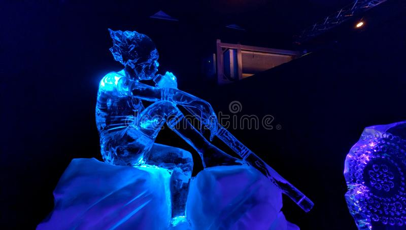 Ice Sculpture man making music royalty free stock images