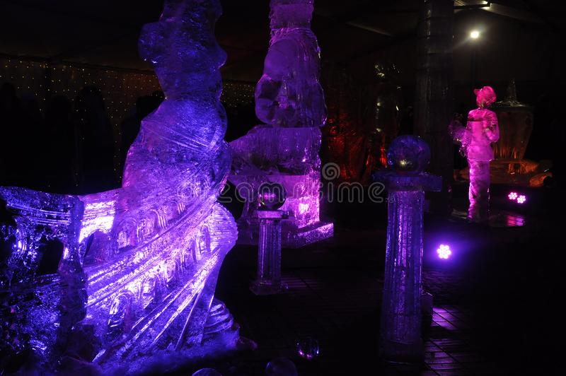 Ice sculptures in blue and violet lights at night of Internetional Ice Sculpture Festival. 2016 in Jelgava royalty free stock photography
