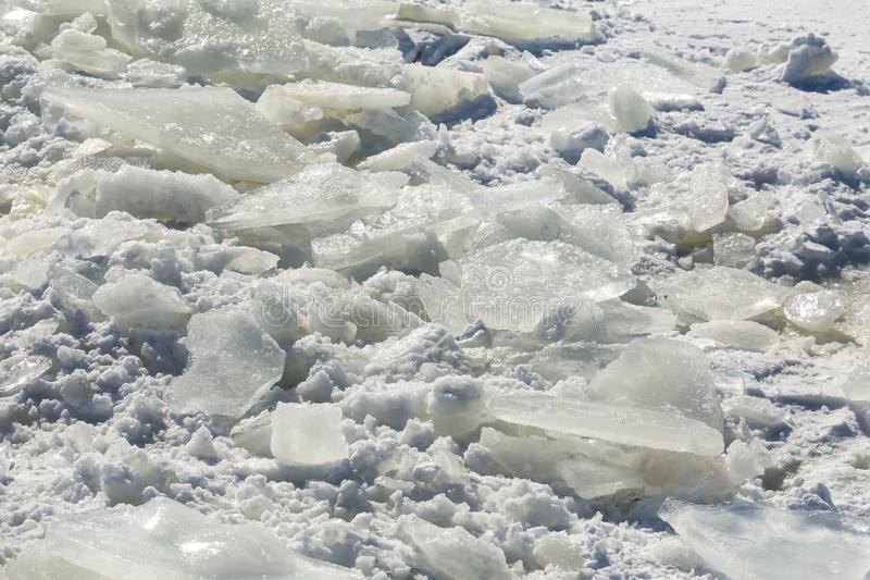 Ice shards in the snow. Sunny winter`s day. Texture background.  royalty free stock photography