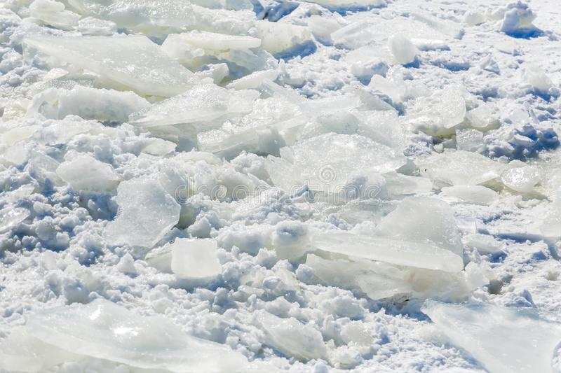 Ice shards in the snow. Sunny winter`s day. Texture background.  stock photo