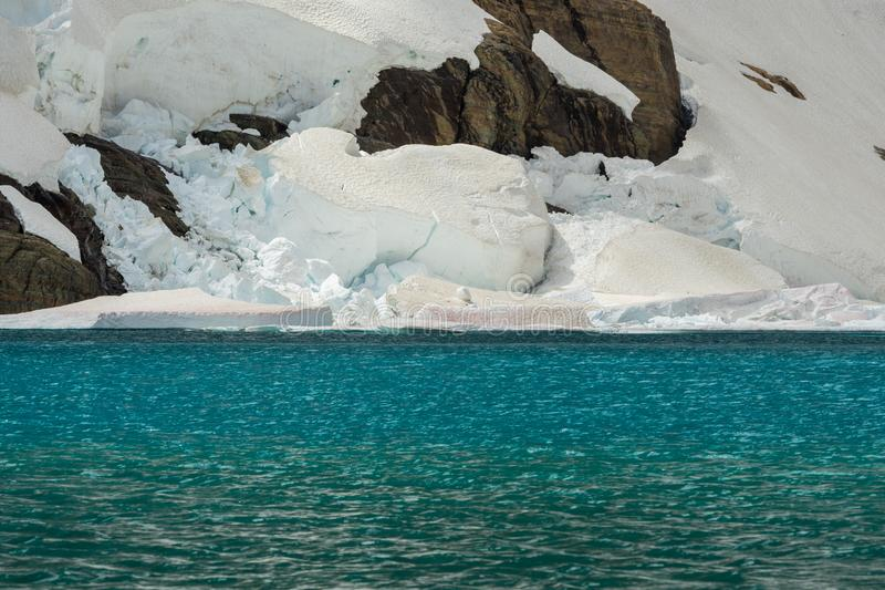 Ice Shelf and Blue Water of Iceberg Lake. In Glacier National Park stock image