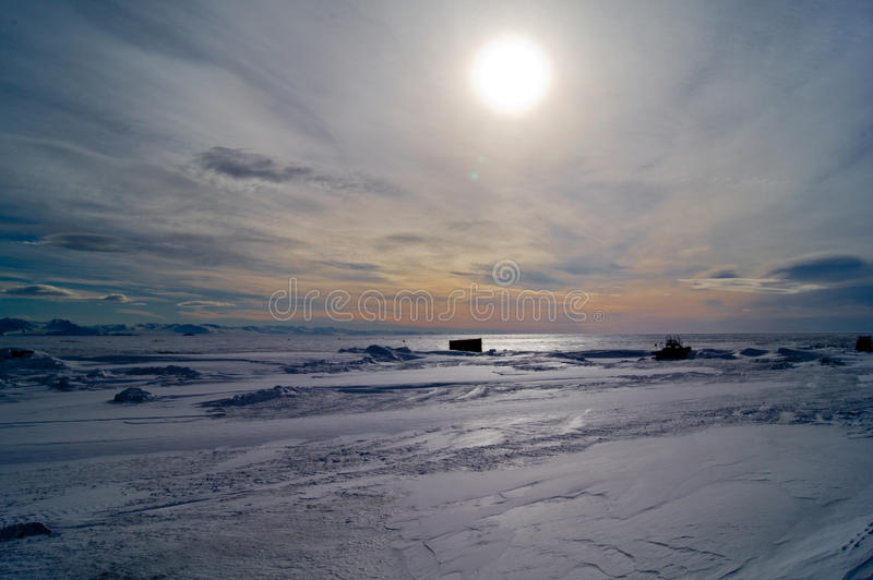 Ice Shelf Skyline. The sun passive overhead in late afternoon on the Ross Ice Shelf stock image