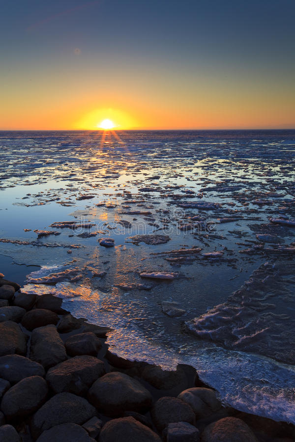 Ice Shelves At Sunset On A Frozen Lake Stock Photo