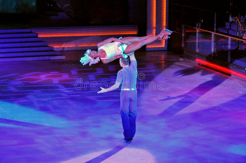 Ice show spectacular. Professional sportsmans ice skaters performing in an ice show production onboard cruise ship Adventure of the Seas stock photography