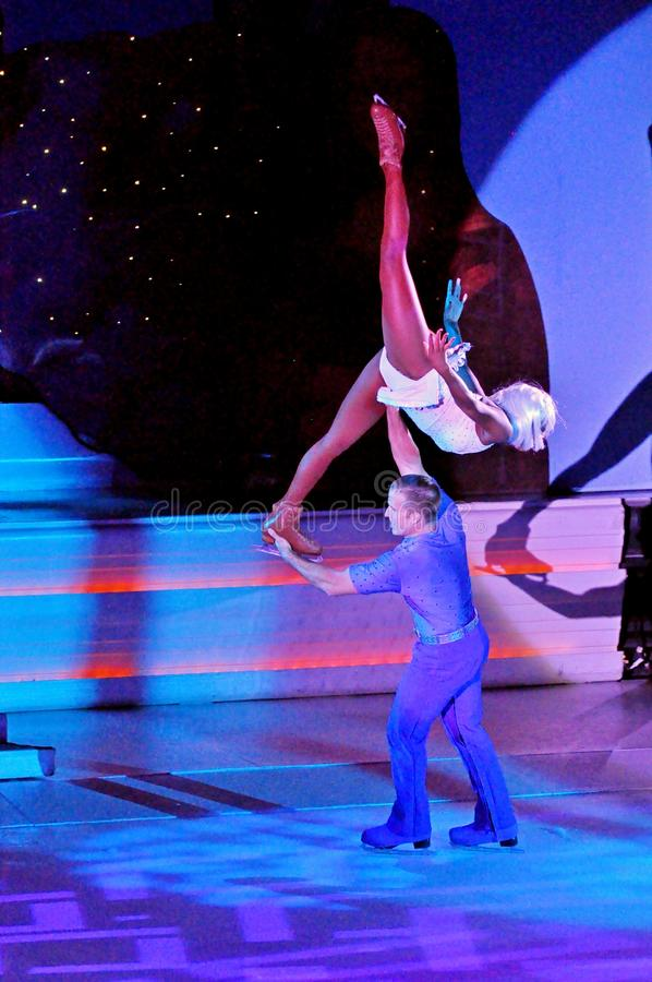 Ice show spectacular. Professional sportsmans ice skaters performing in an ice show production onboard cruise ship Adventure of the Seas royalty free stock photos