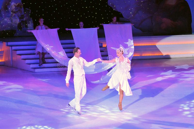 Ice show spectacular. Professional sportsmans ice skaters performing in an ice show production onboard cruise ship Adventure of the Seas royalty free stock photo