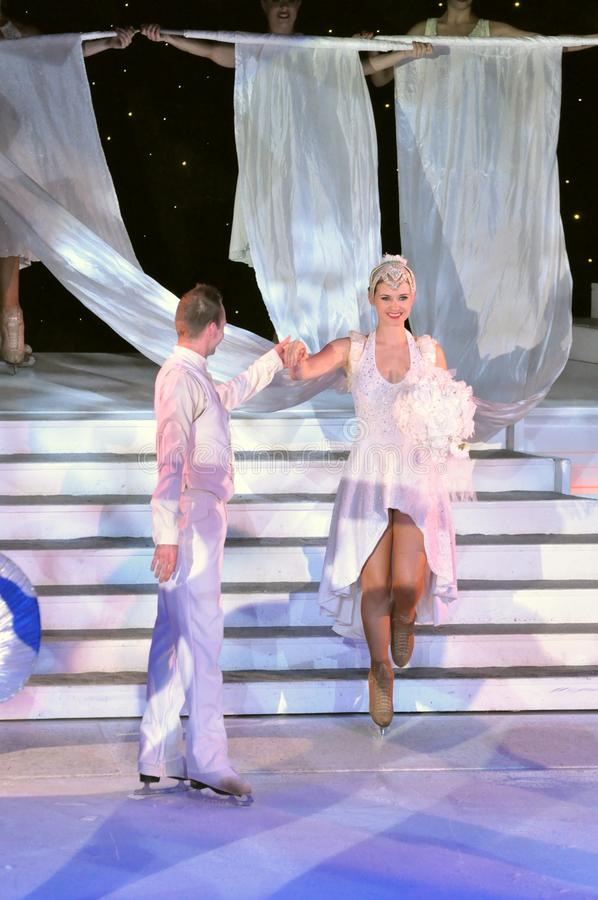 Ice show spectacular. Professional sportsmans ice skaters performing in an ice show production onboard cruise ship Adventure of the Seas stock images