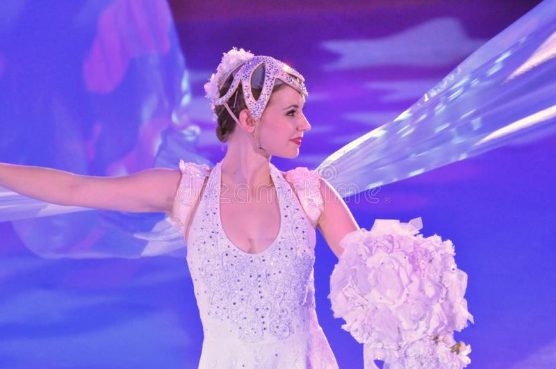Ice show spectacular. Professional sportsmans ice skaters performing in an ice show production onboard cruise ship Adventure of the Seas royalty free stock photography