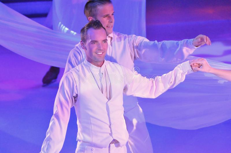Ice show spectacular. Professional sportsmans ice skaters performing in an ice show production onboard cruise ship Adventure of the Seas stock photos
