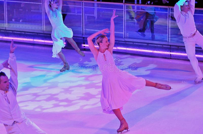 Ice show spectacular. Professional sportsmans ice skaters performing in an ice show production onboard cruise ship Adventure of the Seas stock image