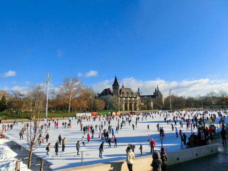 Ice skaters in City Park Rink in Budapest, Hungary. Ice skaters in City Park Ice Rink in Budapest, Hungary. Opened in 1870, it is the largest and one of the royalty free stock photography