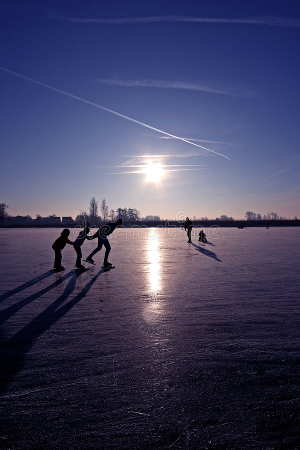 Ice skating on a cold winterday stock photography