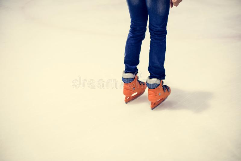 Ice skating on the ice rink leisure and fun lifestyle concept royalty free stock photography