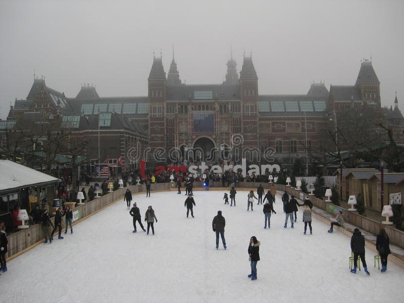 The ice skating rink and Amsterdam sign behind the Rijskmuseum, Netherlands.  stock photo