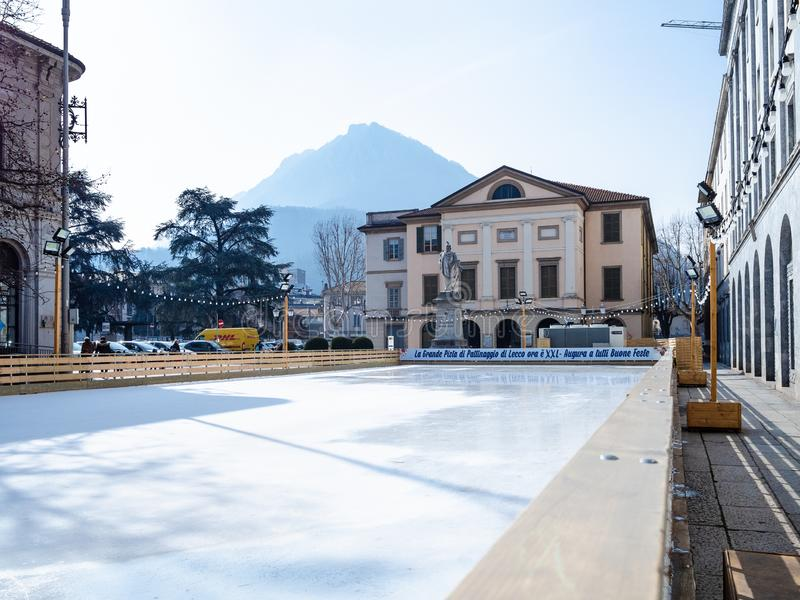 Ice-skating rink in Lecco city, Lombardy. LECCO, ITALY - FEBRUARY 20, 2019: empty ice-skating rink in front of Teatro della Societa Theatre of Society on square stock images
