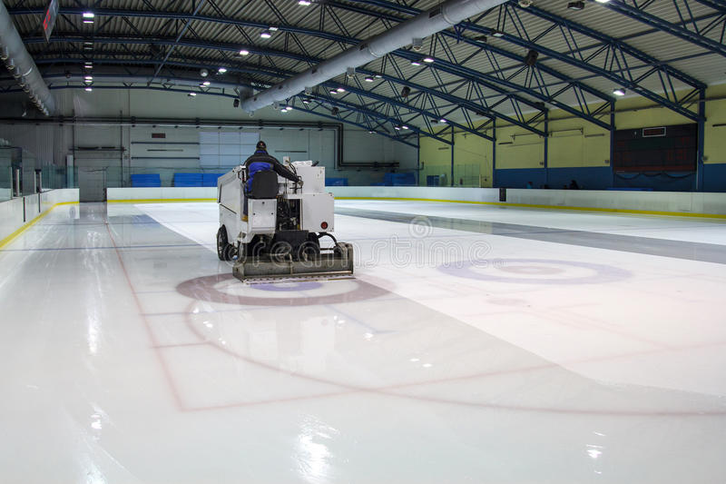 Ice skating rink. Ice resurfacer clean ice in skating rink royalty free stock photos