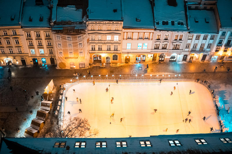 Ice skating rink on the square. In the center of the old town stock images