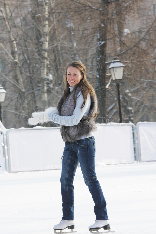 Ice-skating young woman royalty free stock photo