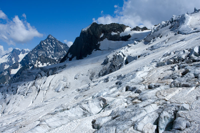 Ice and snow in mountains stock photo
