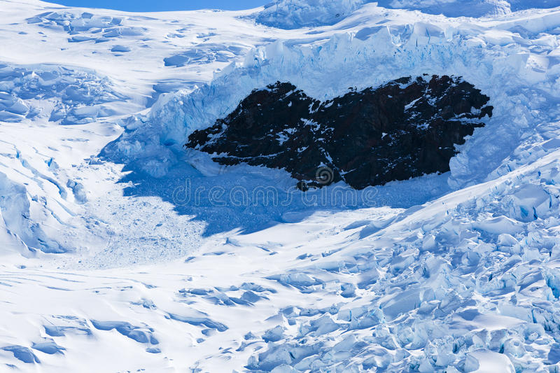 Ice, Snow and rock formation. At Neko Harbour, Antarctica stock photo