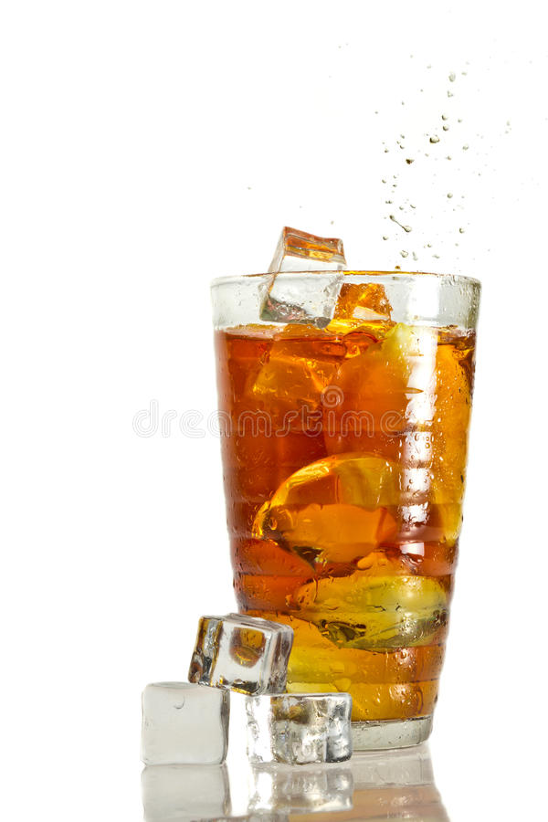 Ice tea with splash in glass royalty free stock photography