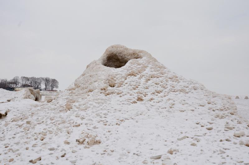 Ice Volcano. This is a Winter picture of the weather phenomenon known ice volcanoes on the lakefront of Chicago, Illinois. They are formed during winter storms royalty free stock photography