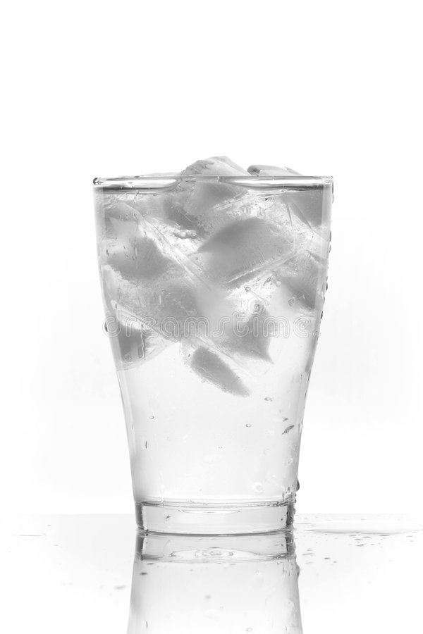 Ice water. Glass of clean water with ice (white background royalty free stock photography