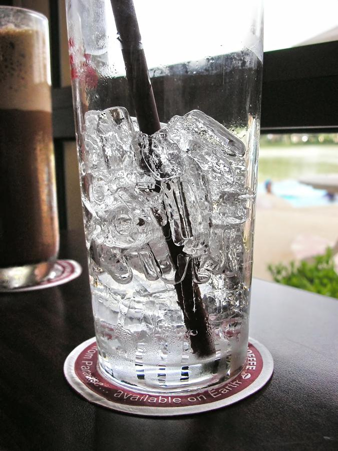 Ice water and coffee stock image