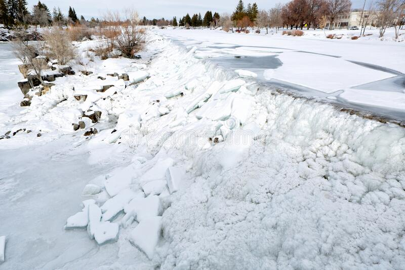 Ice on the waterfall that the City of Idaho Falls, Idaho is named after. The falls freezes on a cold winter day and ice sheets back up on the waterfall that the stock image