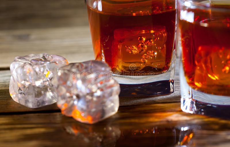 Ice and whisky,. Still life on the surface aged table stock photos