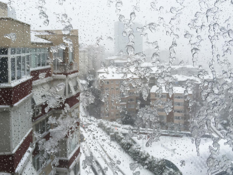 Download Ice On Window Against Street Under Snow Stock Photo - Image: 83700060
