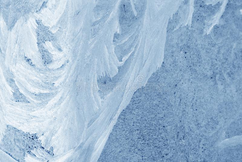 Ice on the window glass, natural background texture royalty free stock photos