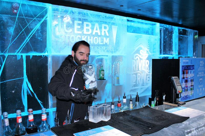 At ICEBAR by ICEHOTEL Stockholm, Sweden. ICEBAR by ICEHOTEL Stockholm was built in 2002 as the world`s first permanent ice bar. Every year, interior and design royalty free stock photo